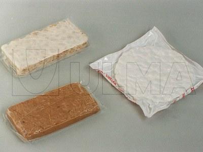Ambalare dulciuri tip nuga (Alicanta, Jijona, nuca de cocos, galbenus de ou) in termoformare cu film flexibil, in vid